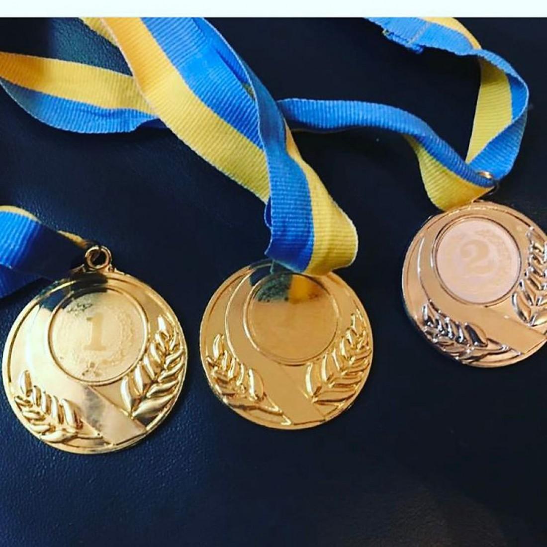 Медали дочерей Оли Поляковой