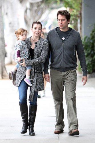 Элисон с мужем Алексисом и старшей дочерью Сатьяной