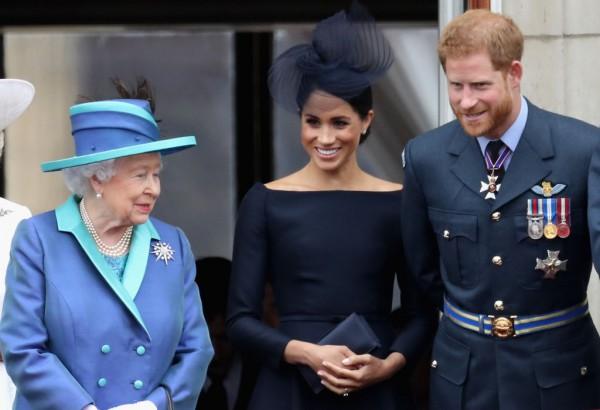 Елизавета II, принц Гарри и Меган Маркл