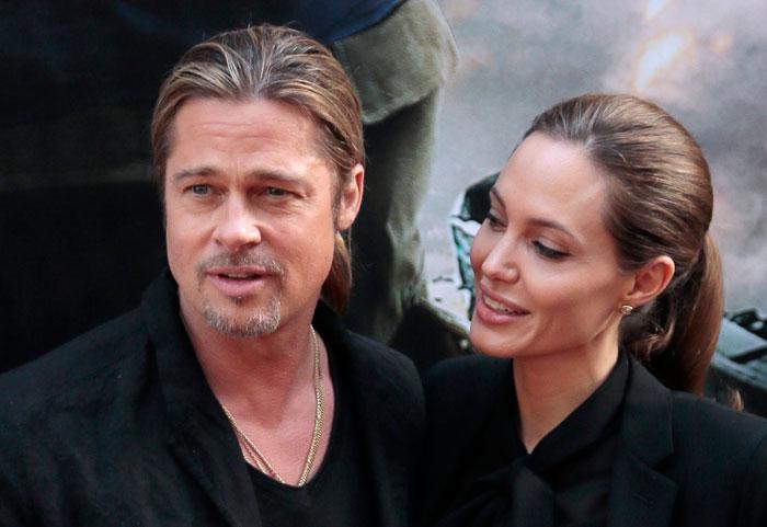 Актер Брэд Питт и актриса Анджелина Джоли диктуют новую моду на одинаковые прически