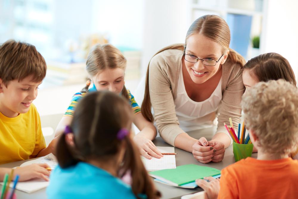 Учитель в группе