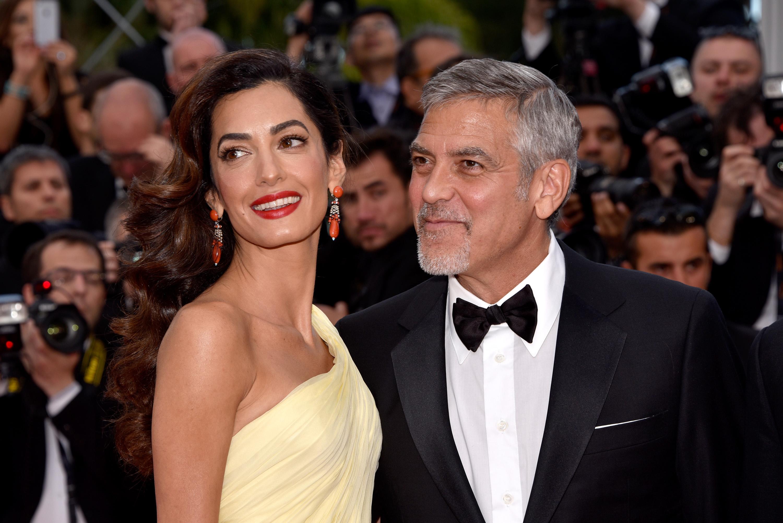 Джордж Клуни и его жена Амаль Аламуддин