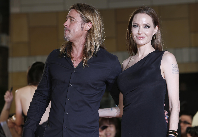 Анджелина Джоли и Брэд Питт на премьере фильма Война миров Z